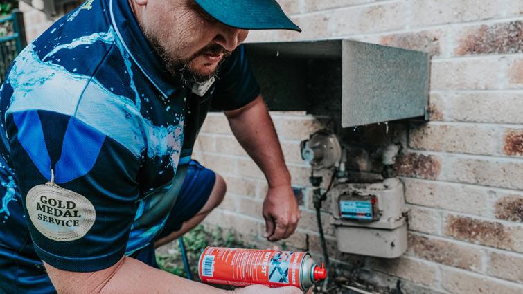 Ben repairing a gas hot water system