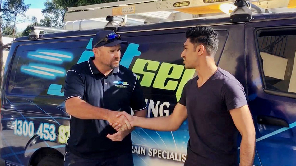 Gold Coast plumber with a happy customer