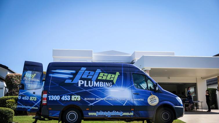 Hey, it's the big blue Jetset Plumbing van!